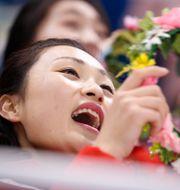Kvinna som deltar i Nordkoreas hejarklack. BRIAN SNYDER / TT NYHETSBYRÅN
