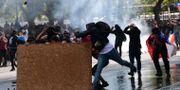 Demonstranter på gatorna i Chile. MARTIN BERNETTI / AFP