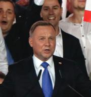 Andrzej Duda och Rafal Trzaskowski.  TT