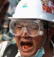 Demonstrant i Myanmar TT NYHETSBYRÅN