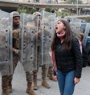Bild från en protest i Beirut i februari. Hussein Malla / TT NYHETSBYRÅN