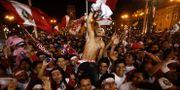 Firande på huvudstaden Limas gator. STR / AFP