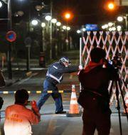 En vakt öppnar grindarna till Futaba Naoya Osato / TT NYHETSBYRÅN