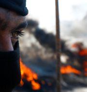 En regeringskritisk demonstrant i Najaf igår. ALAA AL-MARJANI / TT NYHETSBYRÅN
