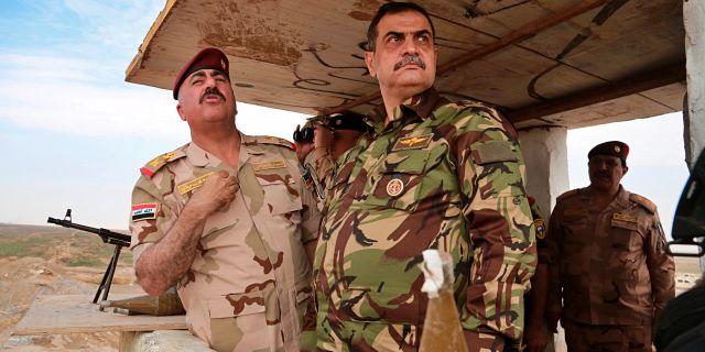 Najah al-Shammari (mitten) Hadi Mizban / TT NYHETSBYRÅN