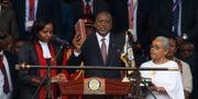 Kenyatta svär presidenteden. THOMAS MUKOYA / TT NYHETSBYRÅN