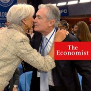 Federal Reserve Chairman Jerome Powell embraces Christine Lagarde, president of the European Central Bank.