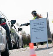 Arkivbild: Bilar i kö för egenprovtagning gällande pågående Covid-19 infektion i Malmö Johan Nilsson/TT / TT NYHETSBYRÅN