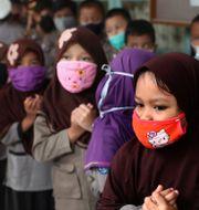 Barn på en förskola i Indonesiens huvudstad Jakarta. Tatan Syuflana / TT NYHETSBYRÅN