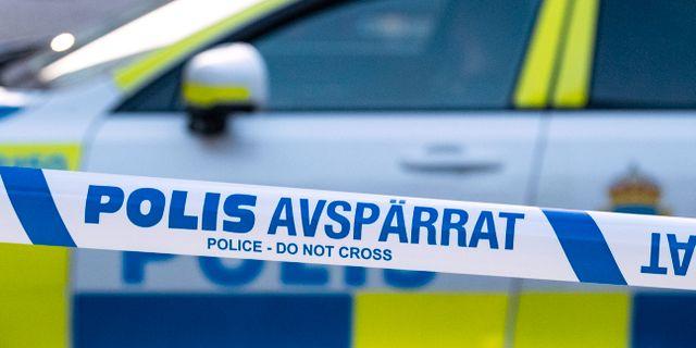 Polisbil och avspärrningsband. Johan Nilsson/TT / TT NYHETSBYRÅN