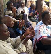 Freeman Mbowe, till vänster i bild. Arkivbild.  KHALFAN SAID / TT NYHETSBYRÅN
