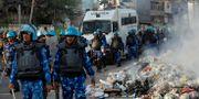 Polis i skyddsutrustning i New Dalhi DANISH SIDDIQUI / TT NYHETSBYRÅN