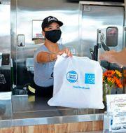 """Bild som distribueras av American Express från bolagets """"Small Business Saturday""""-initiativ för att uppmana kunder att handla från småbolag. Mark Von Holden / TT NYHETSBYRÅN"""