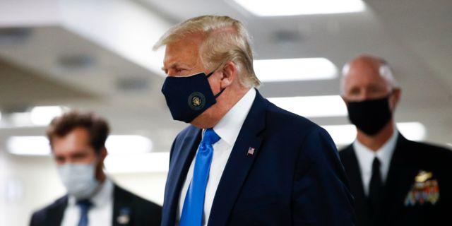 Donald Trump i mask. Patrick Semansky / TT NYHETSBYRÅN