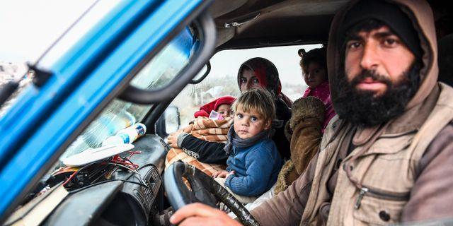 Syrisk familj på flykt. TT NYHETSBYRÅN