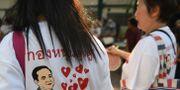 Väljare som stöttar Prayut Chan-o-chas parti Phalang Pracharat . LILLIAN SUWANRUMPHA / AFP