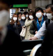 Arkivbild: Pendlare i Tokyo efter virusutbrottet. Issei Kato / TT NYHETSBYRÅN