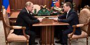 Vladimir Putin och Dimitrij Medvedev. SPUTNIK / TT NYHETSBYRÅN
