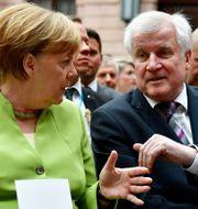 Angela Merkel och Horst Seehofer. Arkivbild. TOBIAS SCHWARZ / AFP