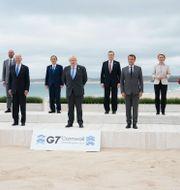 Xi Jinping och G7-ledarna i Cornwall.  TT