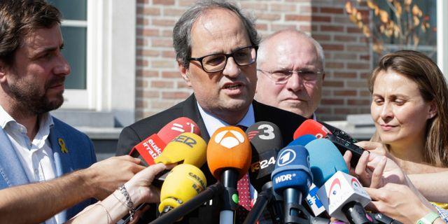 Quim Torra talar med reportrar under lördagen. ARIS OIKONOMOU / AFP