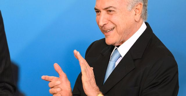 Brasiliens president Michel Temer har åtminstone en anledning av glädjas. EVARISTO SA / AFP
