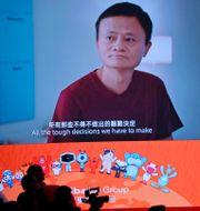 Arkivbild: En bild av grundaren Jack Ma på en skärm i samband med Alibabas listning i Hongkong Kin Cheung / TT NYHETSBYRÅN