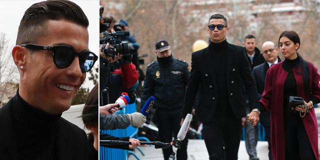 Ronaldo anländer till rättssalen med sin fästmö Georgina Rodriguez. TT