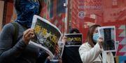 Demonstranter i Hongkong. Mark Schiefelbein / TT NYHETSBYRÅN