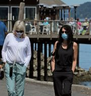 Kvinnor med ansiktsmasker i Washington. Ted S. Warren / TT NYHETSBYRÅN