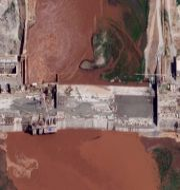 Satellitbild över dammbygget.  TT NYHETSBYRÅN