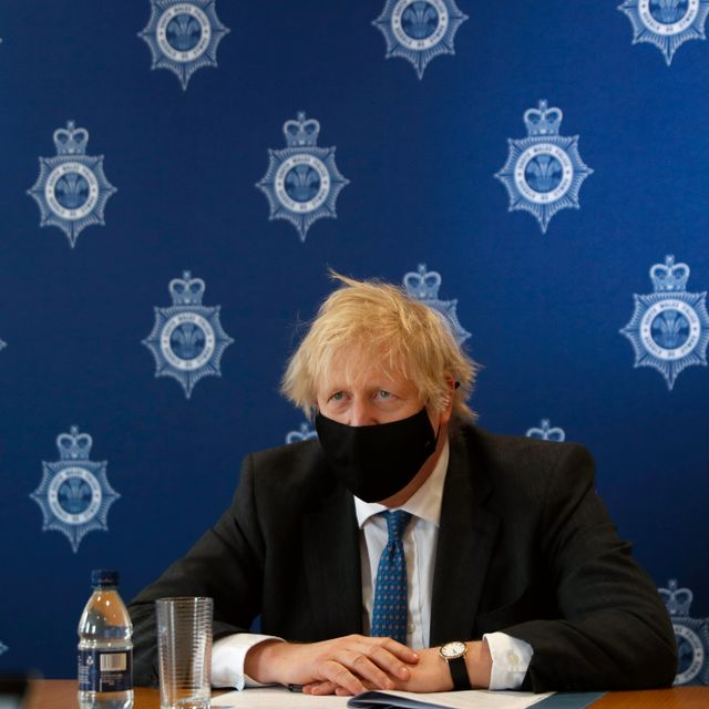 Britain's Prime Minister Boris Johnson listens during a visit to South Wales Police Headquarters in Bridgend in Wales, Wednesday, Feb. 17, 2021. Alastair Grant / TT NYHETSBYRÅN