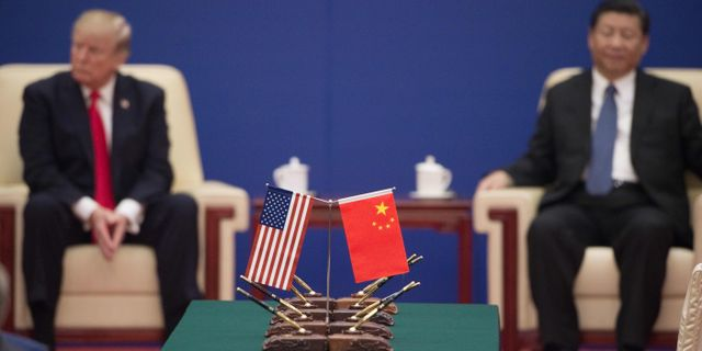 USA:s president Donald Trump och Kinas president Xi Jinping.  NICOLAS ASFOURI / AFP