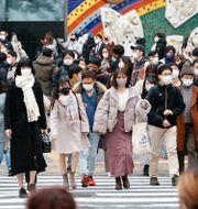 Tokyobor går över vägen på j Masanobu Kumagai / TT NYHETSBYRÅN