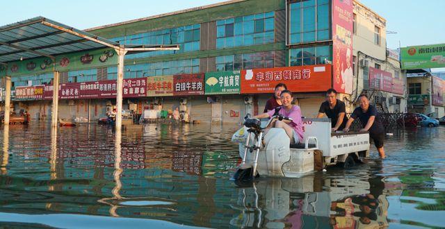 Översvämningarna i Henanregionen. Dake Kang / TT NYHETSBYRÅN