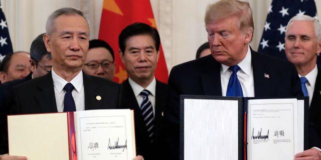 Liu He och Donald Trump. Evan Vucci / TT NYHETSBYRÅN
