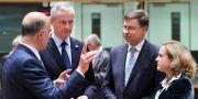 Valdis Dombrovskis med EU-ministrar. EMMANUEL DUNAND / AFP