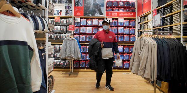 Uniqlo-butik i Peking.  STRINGER / TT NYHETSBYRÅN