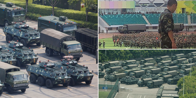 Militära fordon och militär personal vid ett fotbollstadion i Shenzhen TT