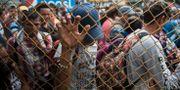 Bild från Guatemala där migranter väntar för att försöka ta sig till Mexiko.  Oliver de Ros / TT NYHETSBYRÅN