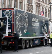 Lastbilar i London. Alastair Grant / TT NYHETSBYRÅN