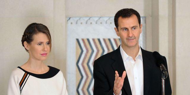 Bashar al-Assad med hustrun Asma al-Assad. Arkivbild. STRINGER / AFP