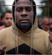 En man i ett flyktingläger i Litauen. Mindaugas Kulbis / TT NYHETSBYRÅN