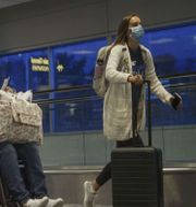 Resenärer på Charlotte International Airport, North Carolina, i maj. TT