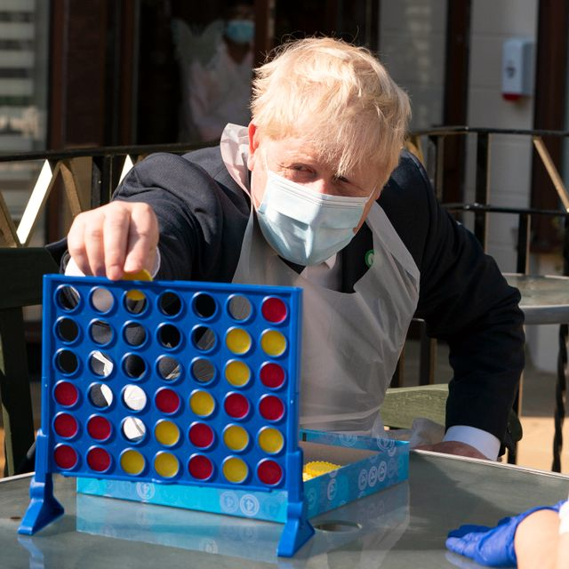 Britain's Prime Minister Boris Johnson plays Connect 4, during a visit to Westport Care Home in Stepney Green, east London, Tuesday, Sept. 7, 2021, ahead of unveiling his long-awaited plan to fix the broken social care system. Paul Edwards / TT NYHETSBYRÅN