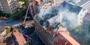 Två bostadshus i Malmö började brinna natten till fredag.  Johan Nilsson/TT / TT NYHETSBYRÅN