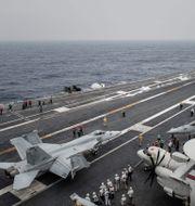 Amerikanskt stridsflyg utanför Hongkongs kust. Arkivbild. PHILIPPE LOPEZ / AFP