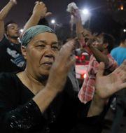 En kvinna som deltog i protesterna i Egypten igår. MOHAMED ABD EL GHANY / TT NYHETSBYRÅN