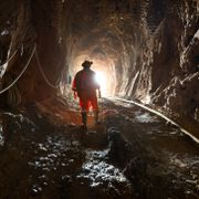 Region del Maule, Chile - Miner inside the access tunnel of an underground gold and copper mine. Shutterstock