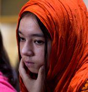 Barn till Uigur-kvinnor som försvunnit i arbetsläger. Arkivbild. B.K. Bangash / TT NYHETSBYRÅN/ NTB Scanpix
